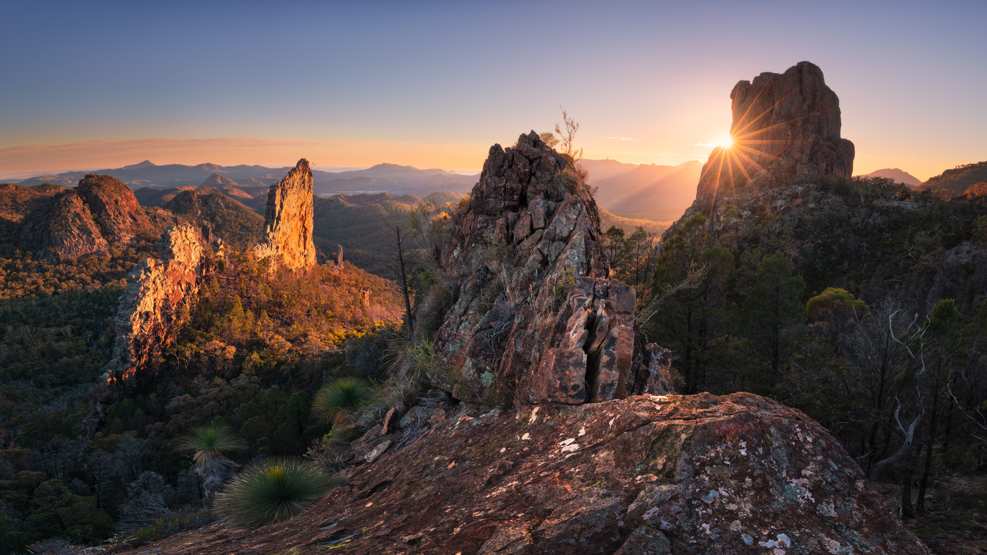 Sun rising over the Breadknife rock formation in Warrumbungle National Park | Travel NSW | Forward Travel