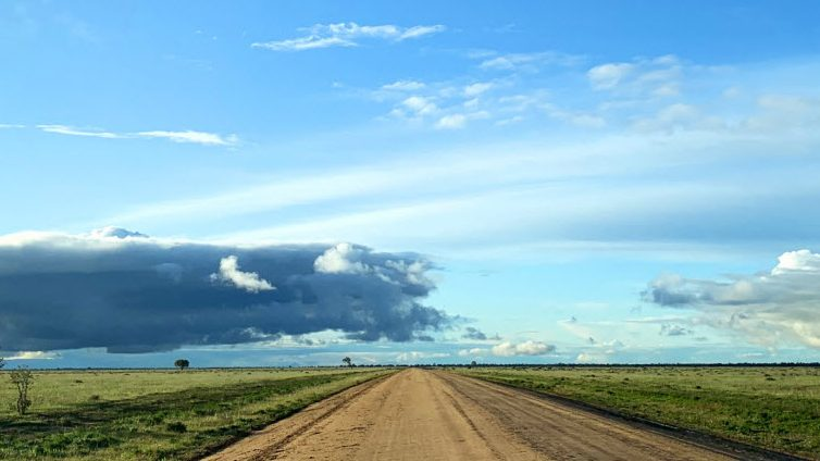 Road in Hay Plains with a beautiful set of clouds